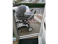 Stokke crusi pram for sale in black melange