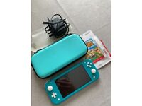 Nintendo Switch Lite turquoise with animal crossing new horizons