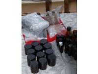 12 x 50g jars, 18 bottles various sizes, mainly 10ml, all with lids and stoppers for bottles