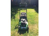 Petrol self propelled lawn mower
