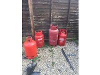 Gas bottles (propane red) 3 medium size & 1 large size