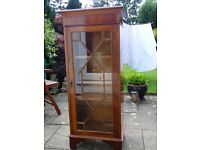 Yew wood glass fronted display cabinet