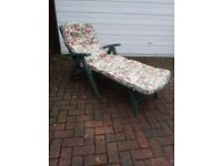 Folding garden recliner with mattress.