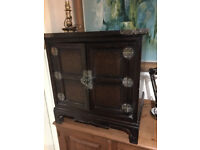Charming Vintage Lockable Oriental Dark Wood 2-Door Cabinet with Brass Hardware