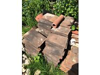 Clay reclaimed roof tiles. About 400