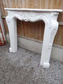 fire surround in excellent condition, heavy , in a marble effect.