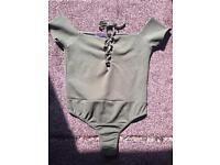 Green bodysuit size 10