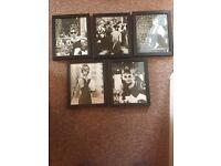 Set of 5 black frames with prints.