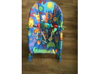 Baby rocker with vibrating seat