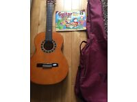 Guitar with book and case