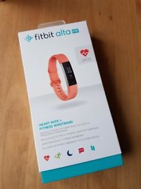 Fitbit alta hr watch. Coral strap size small. BRAND NEW
