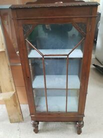 Wooden cabinet with glass front