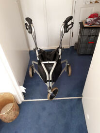 Three wheeled folding Walker with brakes. Bag attached