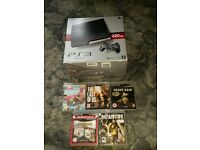 Playstation 3 plus small assortment of games