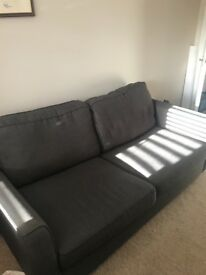 Grey Sofa Bed in Modern Style. Comfortable for lounging on. Bed used twice only