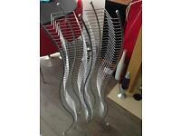 Curvy metal cd rack