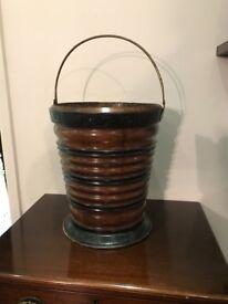 Antique wooden peat bucket.