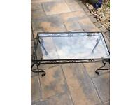 Black wrought iron and glass coffee table