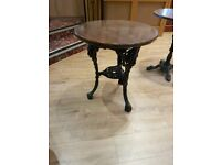 7 left. now..Vintage antique traditional pub table with cast iron base Round table