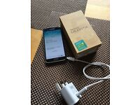Samsung galaxy s5 in black unlocked with box and charger