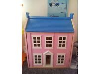 LARGE PINK WOODEN DOLLS HOUSE COST 150