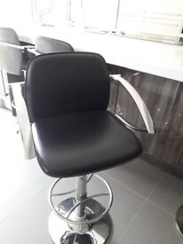 4 black and chrome bar stools