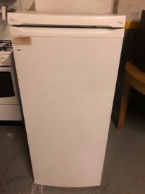 Tall Fridge with small freezer in excellent clean working condition deliver