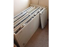 11 modern wall mounted radiators with thermostats, various sizes enough for 3 bedroomed house.