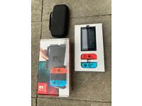 Nintendo switch with box, carry case, and headset