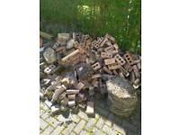 Big amount of bricks and hexagonal slabs