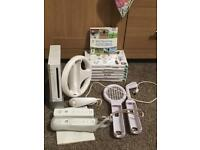 Wii console + 7 games mario kart and wii play good condition