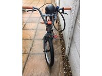 Schwin BMX with No Fear Helmet and a lock.