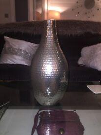 hammered metal vase
