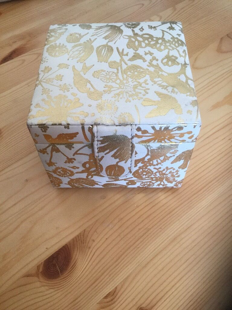 Jewellery box (originally bought from Debenhamsin York, North YorkshireGumtree - Gold/cream jewellery box for sale originally bought from Debenhams. Has inside mirror, ring cushion (slight mark on middle ring cushion), compartment that lifts up and inner drawer. Has a magnetic fastening. In good condition overall. Collection from...