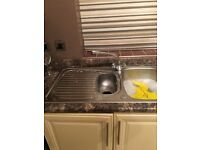 Single drainer sink with taps