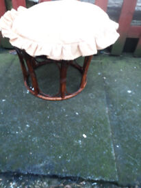 brown cane stool with cushion on the top
