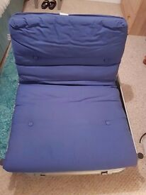 Single chairbed with mental frame and royal blue padding