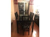 Gloss black dining table with 6 chairs