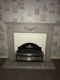 Coal effect electric fire with surround. Good condition