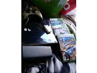 Xbox 360 with controller and 3 games