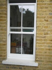 Quality Victorian sash windows in the finest PVCu with period wooden architrave surround