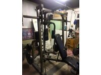Nautilus Smith Machine Multi-Gym with various attachments and approx. 96kg of olympic weight.