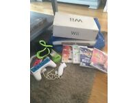 Wii console with Wii Fit, games and accessorise