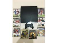 Sony PS3 , 250 GB, with 8 games and dual shock controller!