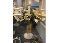 Set of cream candelabras for wedding or event