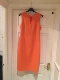 Orange summer dress ideal for occasions