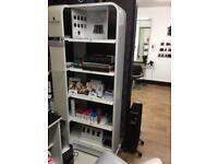 White Schwarzkopf salon retail display stand