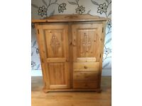 CHUNKY PINE STORAGE UNIT WITH ORNATE DOOR DESIGNS