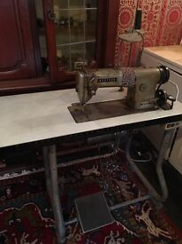 Beautiful sewing machine on own table