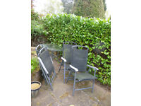 glass garden table and 4 chairs original good quality requires a clean up house sale forces sale